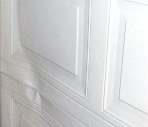 How To Deal With Dents In Your Metal Garage Door Garage Doors Metal Garages