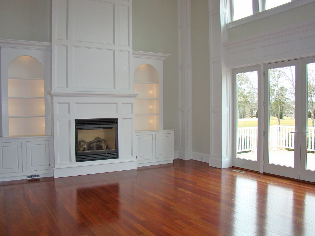 Wood floors large windows built in wall shelves fire place yes