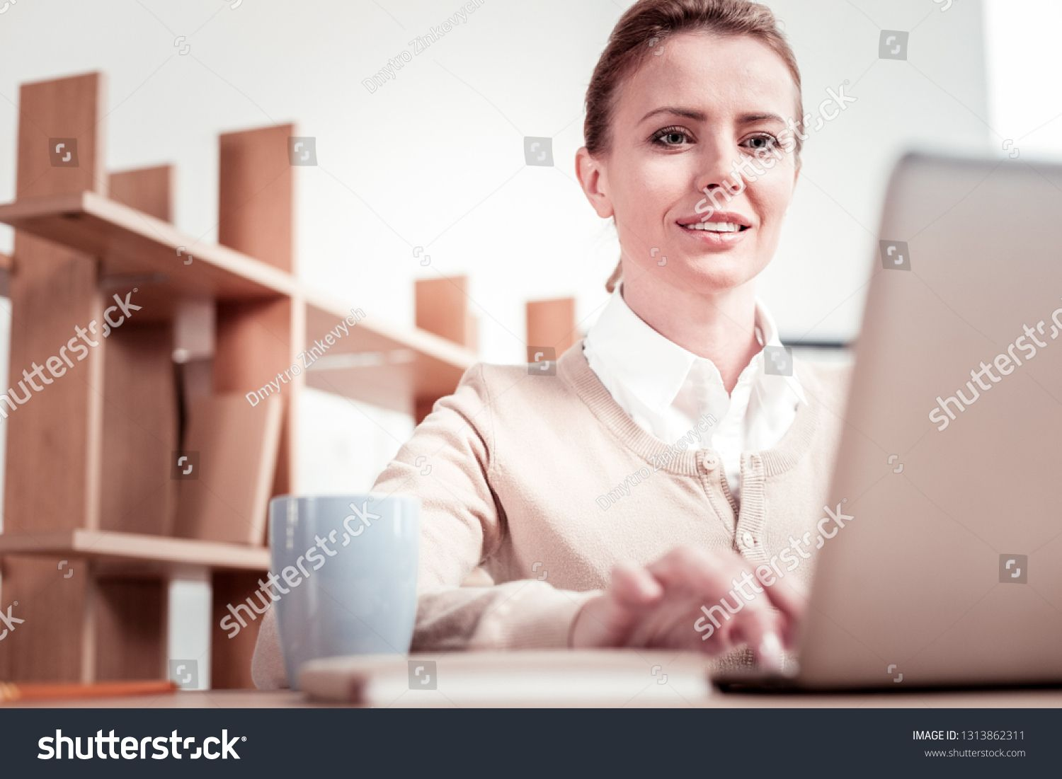 Skilled practitioner. Clever grey-eyed skilled practitioner feeling excited while being involved in new project creation sitting at work place #Ad , #Affiliate, #eyed#skilled#feeling#grey
