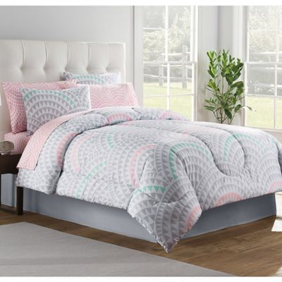 Accessorize your bedroom with the stylish Alexa Comforter Set. Decked out in a unique modern design in mint, grey and pink hues, the chic bedding is the perfect way to liven up any room's décor.
