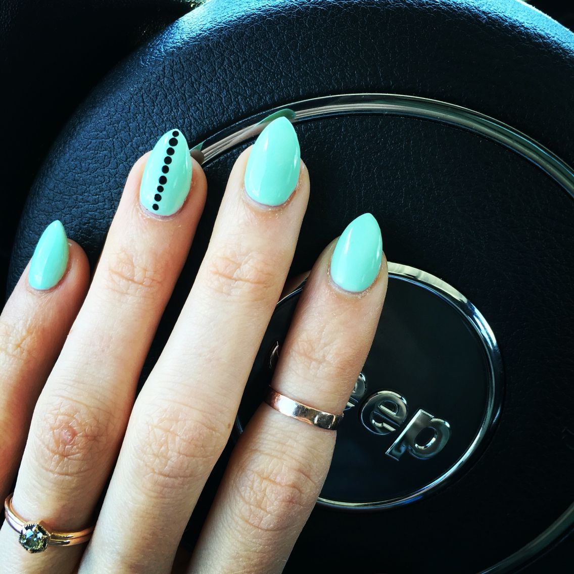 Mint stiletto nails with black dots on accent nail nail ideas