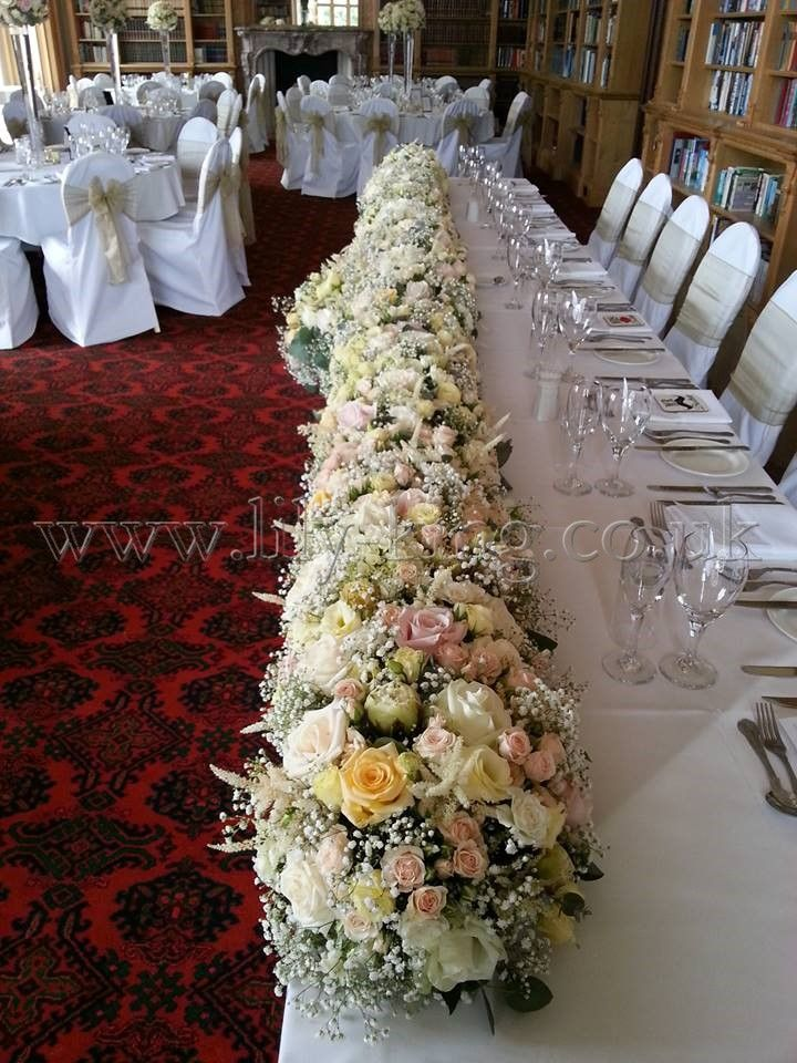 Large top table flower garland arrangement, filled with Roses, by Lily King Weddings