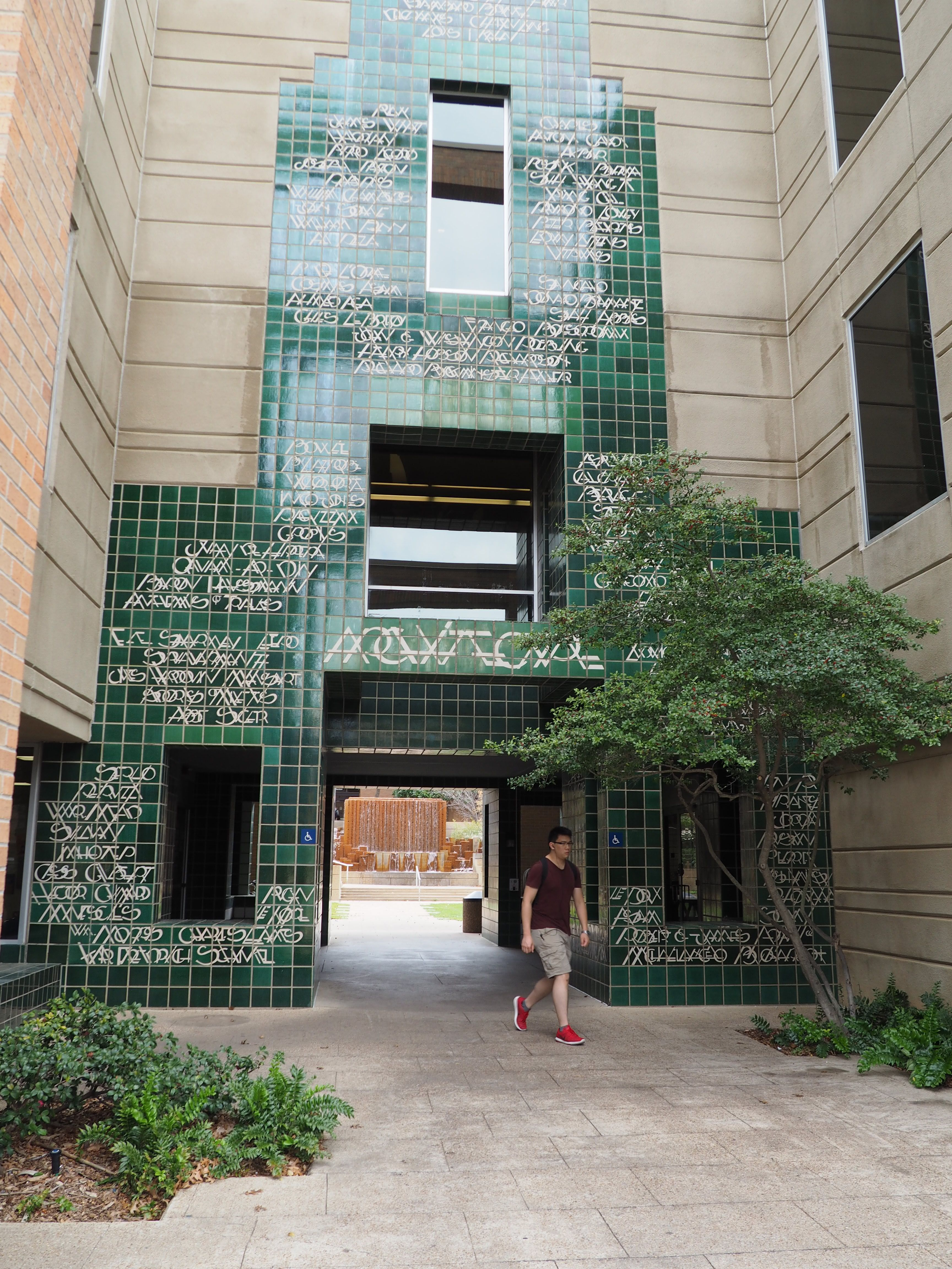 The green tiles on the entrance to the architecture building at UTA