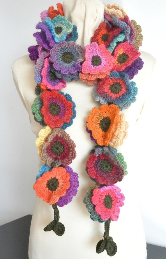 Thanks for looking This scarf is made with multicolor wool yarn, dark green wool and acrylic blend yarn. All the 63pcs of 3.5-3.75 flowers are all hand crocheted. the length is about 74。 Length can be made to order.