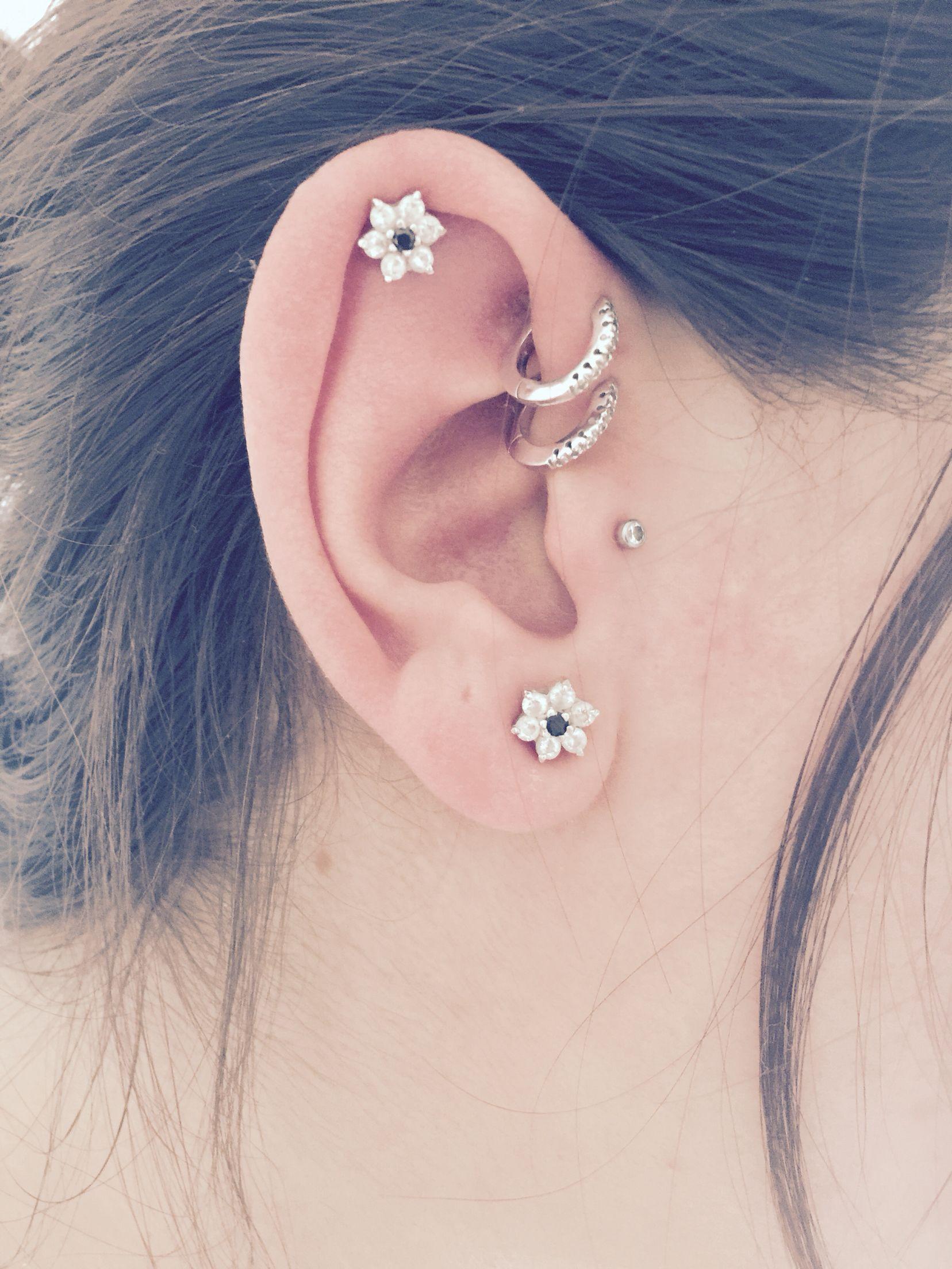 Piercings Double forward helix with hoop piercings Tragus