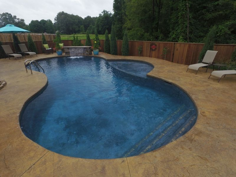 Custom Gunite Freeform With Radius Step Tanning Ledge Stone Sheer Descent Waterfall And Colored Stamped Cantilever D Tanning Ledges Pool Photos Custom Pools