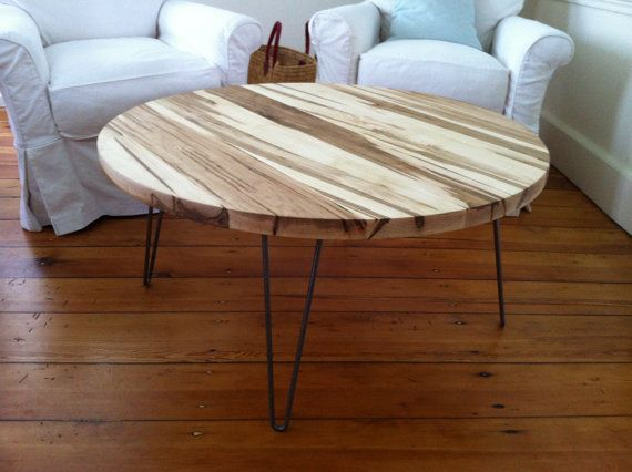 round coffee table, midcentury modern featuring wormy maple top