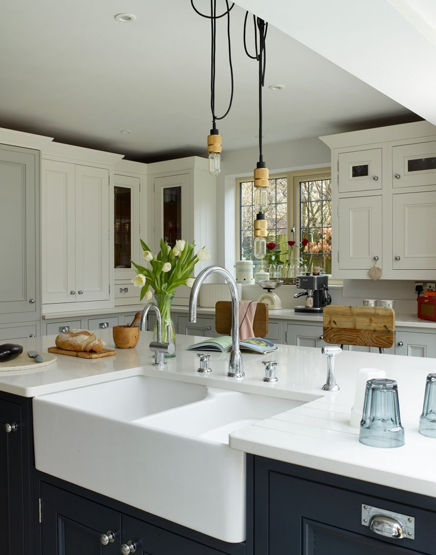 Modern Country Kitchen With A Mix Of White And Navy Cabinetry