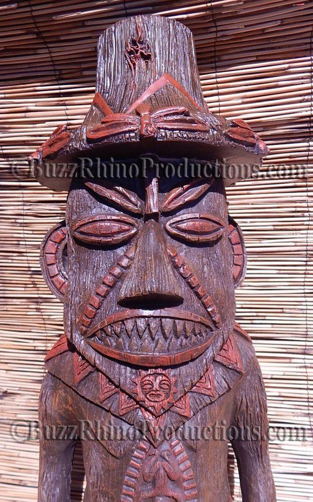 Pele Statue Tiki Torch Bar Room