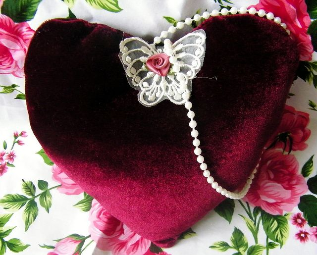 Lovely old deep red velvet fabric heart, with lace butterfly and pearl hanger