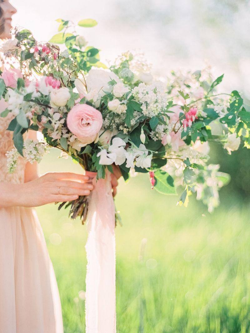 Wedding ideas for summer  Pastel Wedding Ideas amongst blossoming apple trees via Magnolia