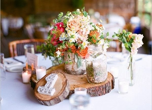 Rustic homemade log centrepieces hot chocolates blog httpwww rustic wedding decorations diy style crafts design d cor my mum used to have some of these old wood cuts to place hot pots on them with some imagination junglespirit Choice Image