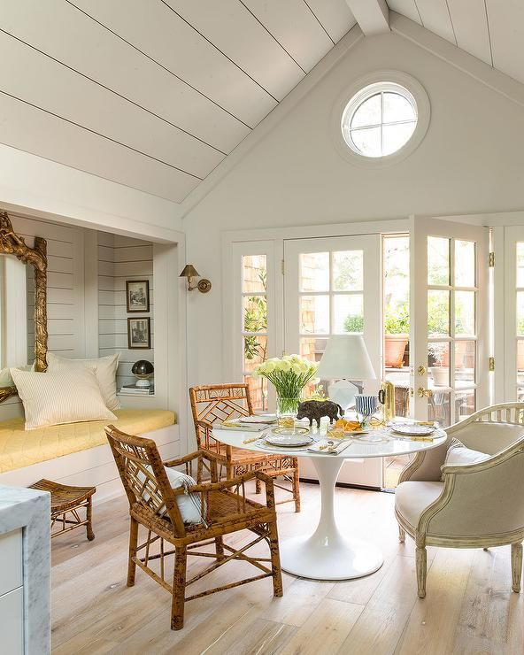 Chic Dining Room Features A Shiplap Vaulted Ceiling Placed