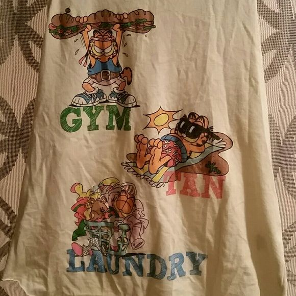 Garfield tank top Garfield's version on Gym, Tan and Laundry not sure the Situation or Pauly D would approve! Really soft fabric bought from Forever 21 at the height of the Jersey Shore phenomenon!! Worn maybe twice didn't fit like a medium as far as I'm concerned it's a large, too much side boob for me. Wear with a bandeau is my suggestion Forever 21 Tops Tank Tops