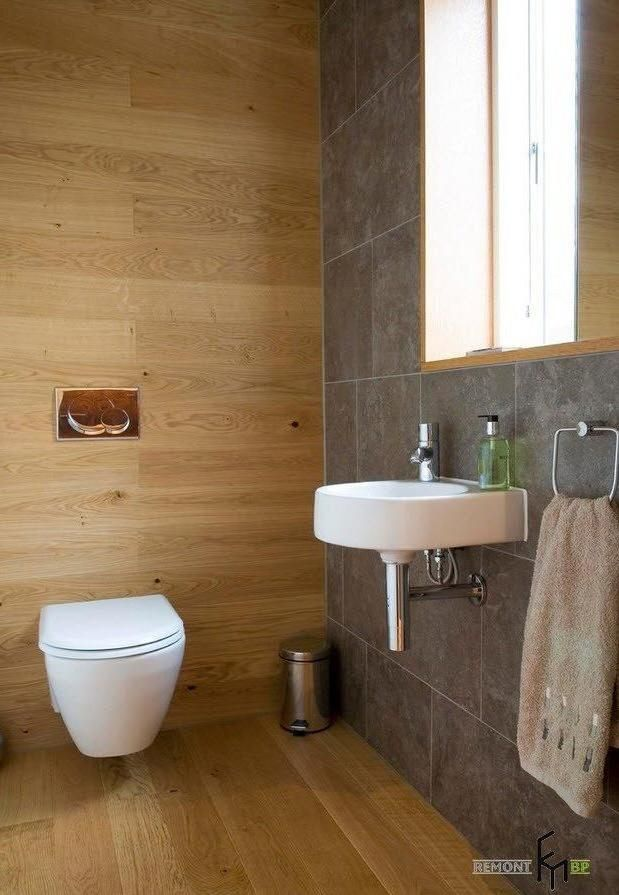 Gray stone tile design in a small toilet with floating sink and sitting toilet also wooden floor - Wall dizain pic ...