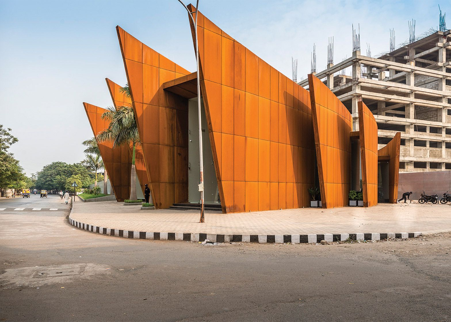 Modern Architectural Features sanjay puri's arching office building features weathering steel