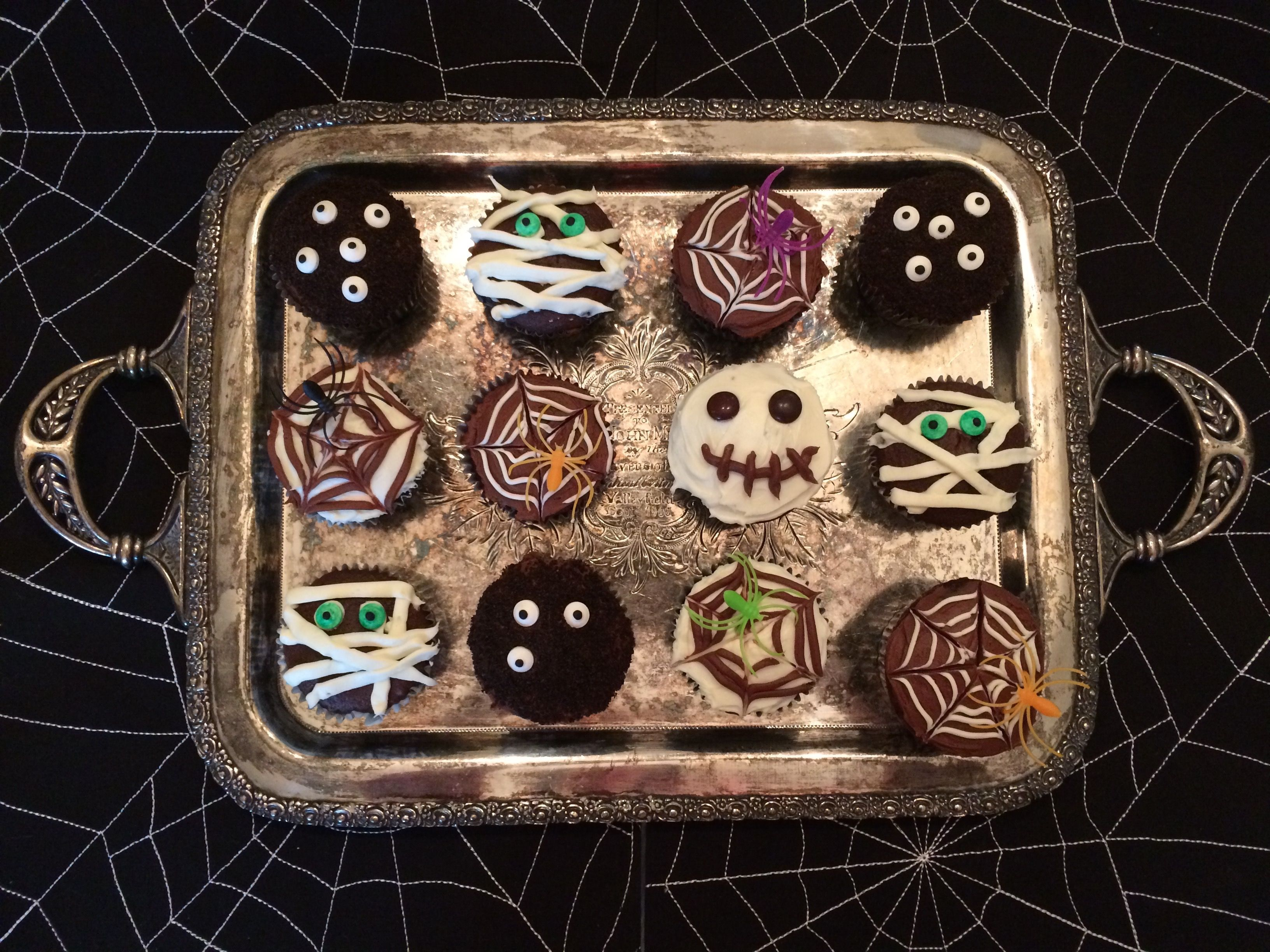 Cream cheese filled chocolate cupcakes with fun halloween designs for the child in all of us!