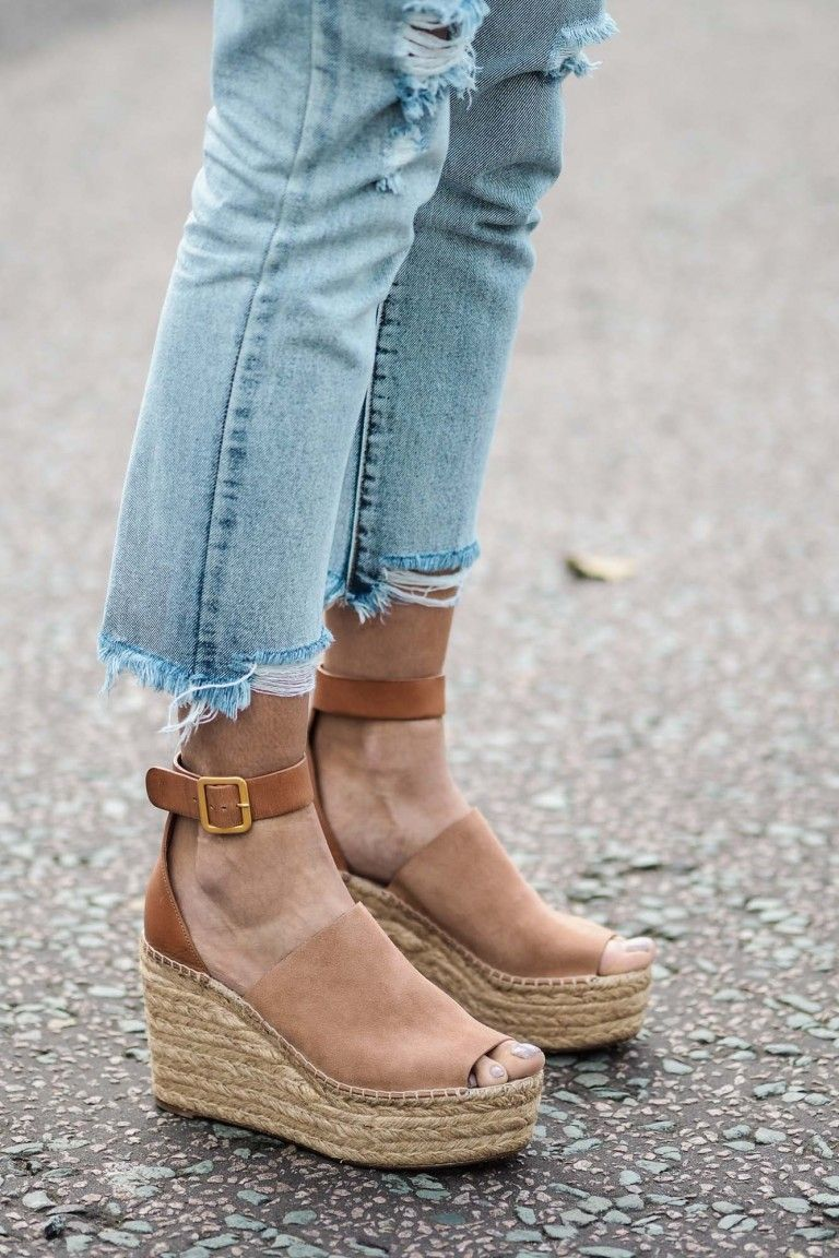 Photo via: EJ Style Emma is not only making us want more raw-hem jeans, but  a cool pair of espadrille wedges as well. Her camel Chloé wedges are  certainly ...
