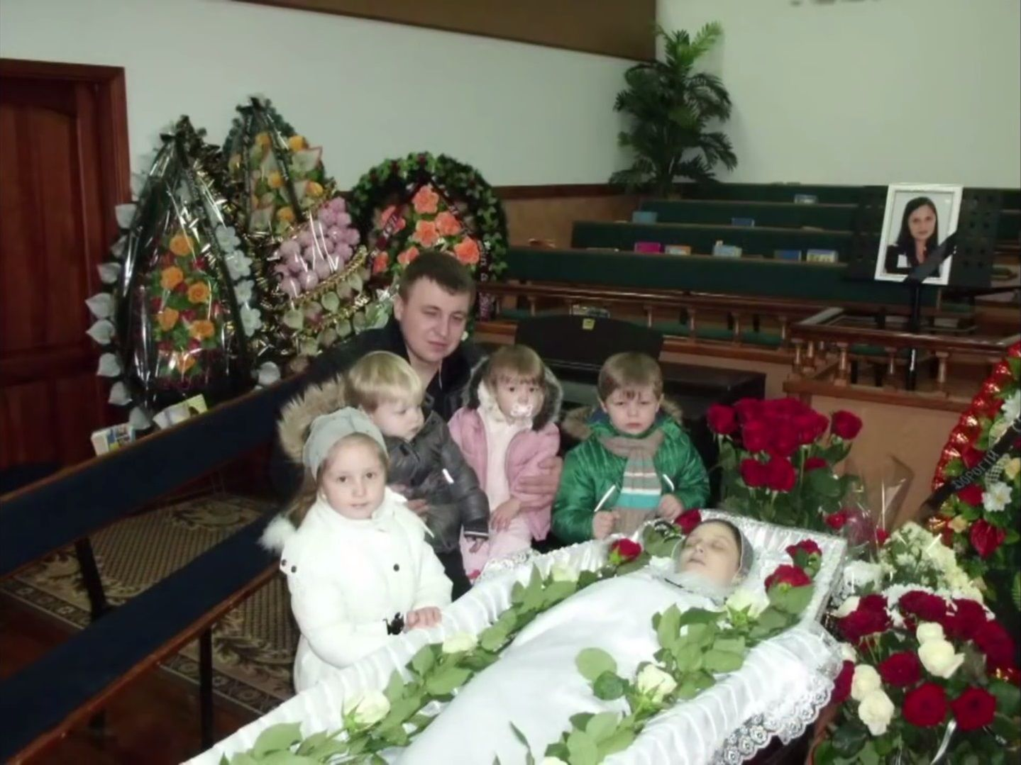 ludmila gulchuk s family stands beside her open casket during her