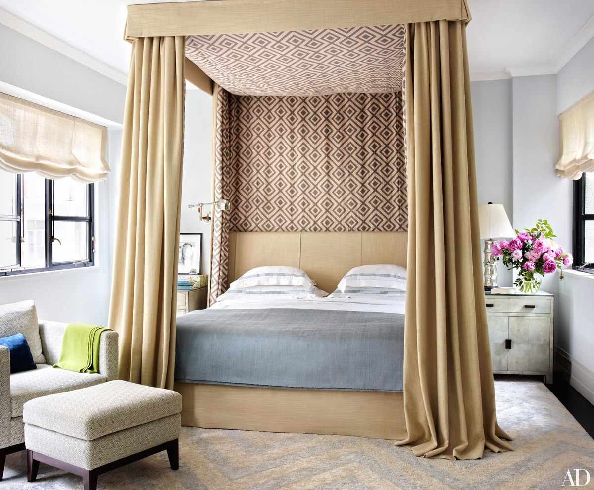In the master suite of accessories designer Fiona Kotur's Hong Kong home, a Great Plains linen is used for the bed's upholstery, canopy, and curtains, complemented by lining of a printed linen by David Hicks for Groundworks.