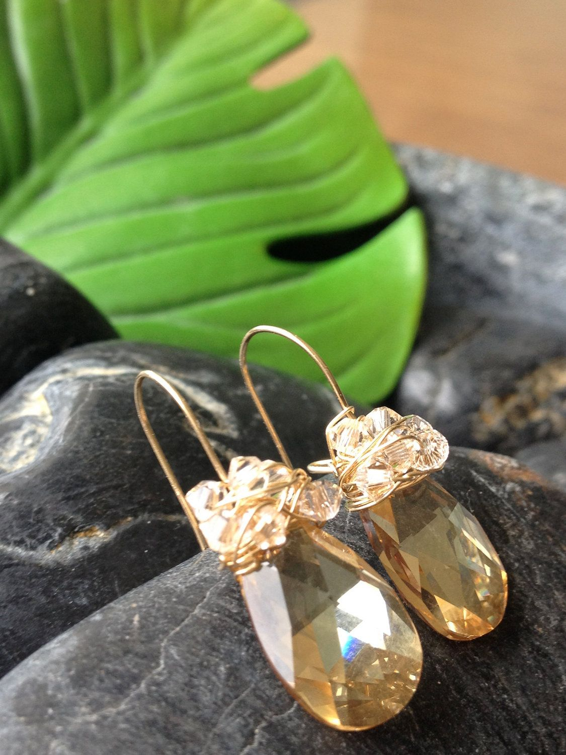 Gold Crystal Earrings topped with Wire Wrapped Crystals. $68.00, via Etsy.