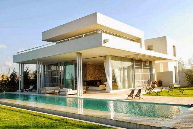 Top 10 fachadas de casas modernas com paisagismo e muros for Fachadas de casas en miami florida