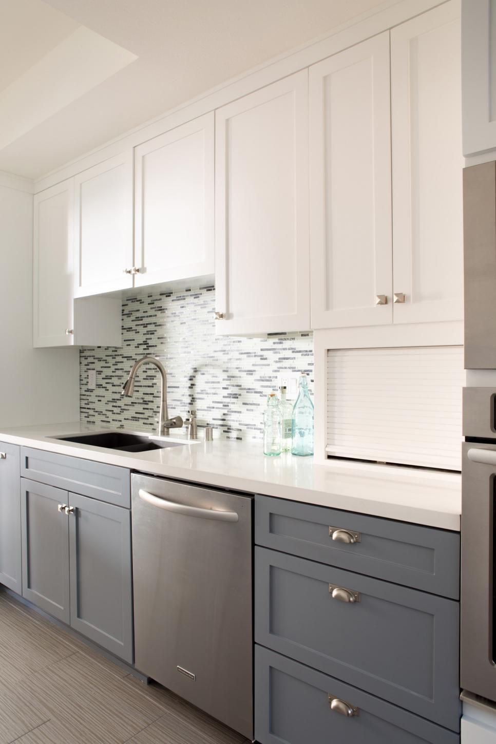 Light Plays Off The Glass Tile Backsplash And Stainless Steel Dishwasher And Adds A Sleek T Tall Kitchen Cabinets Outdoor Kitchen Cabinets New Kitchen Cabinets