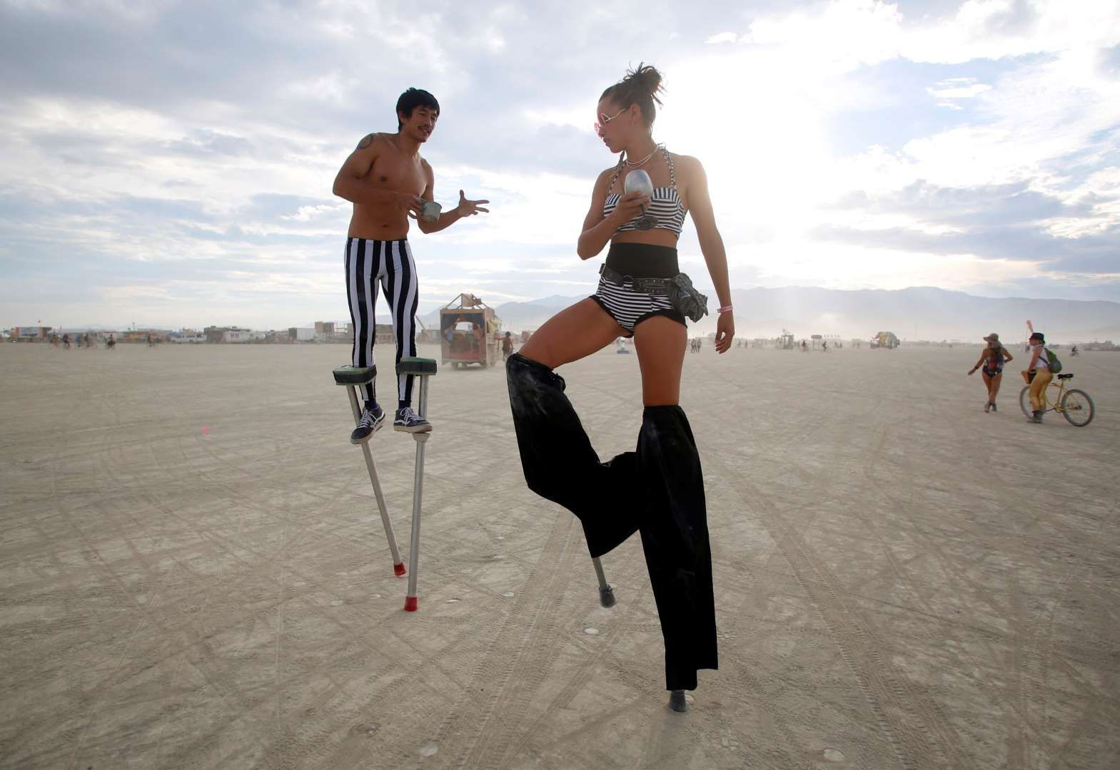 Divine Mustache (L) and Katapult Sandra, their Playa names, dance on stilts on Aug. 29.