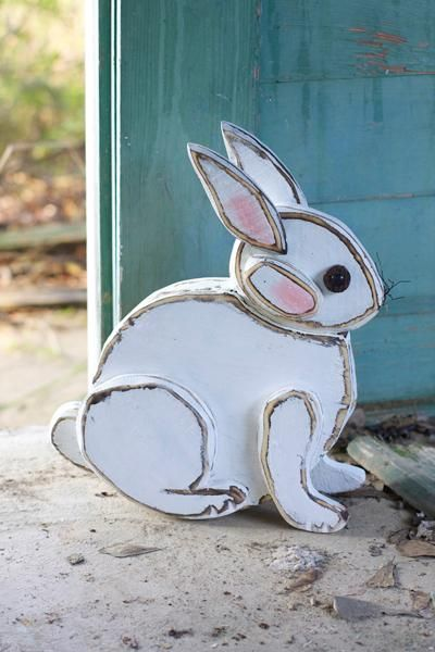 wooden bunny sitting