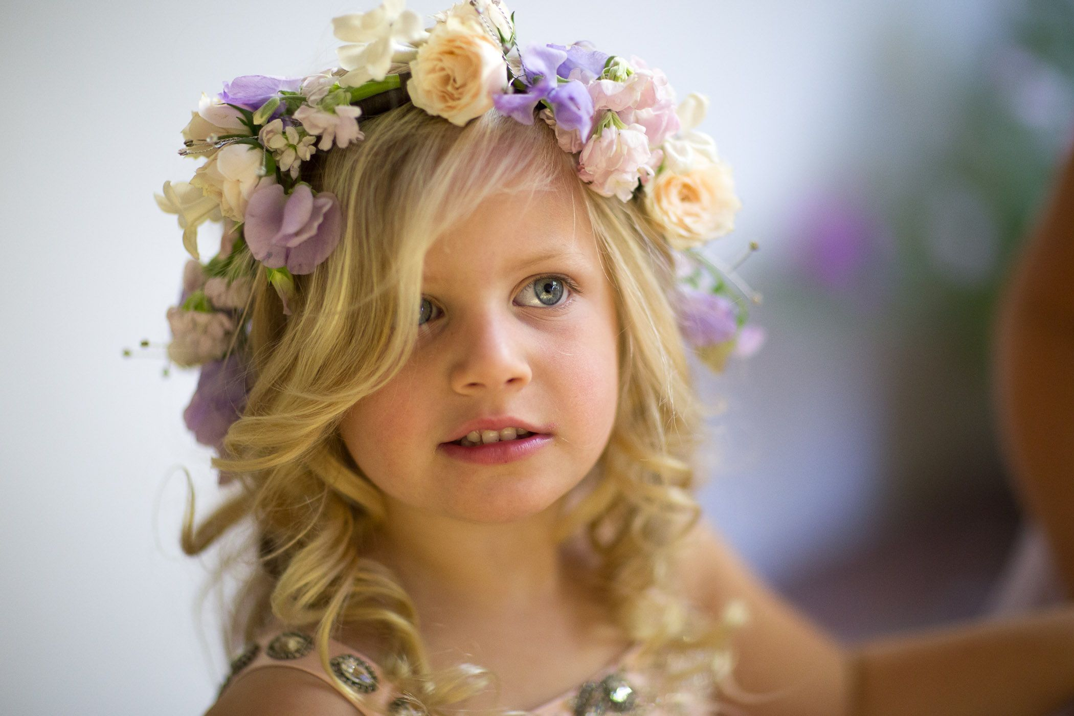 This sweet flower girl donned a floral crown for a Santa Barbara wedding. Event Design By Merryl Brown Events