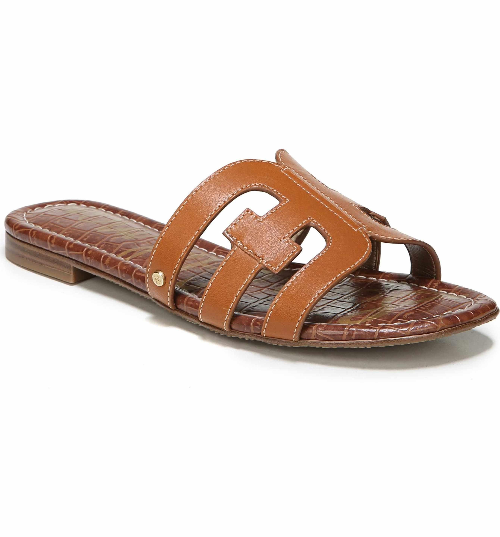 b6cc3b813498 Sam Edelman Bay Cutout Slide Sandal in tan - great dupe for Hermes Oran  sandals