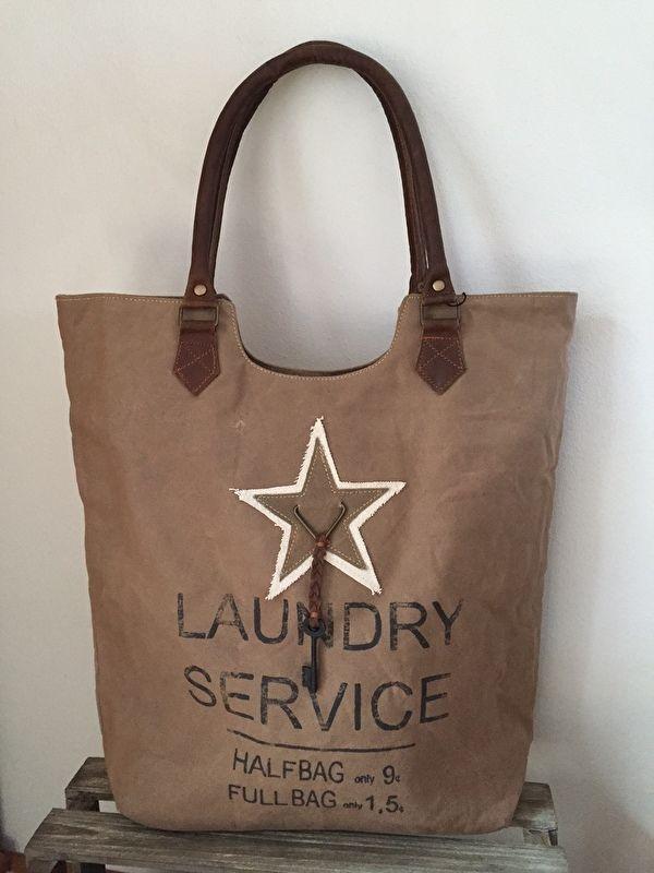 db63767a65f Stoere ruime schoudertas met tekst Laundry Service Carnvas tas met lederen  hengsels van Colmore by Diga