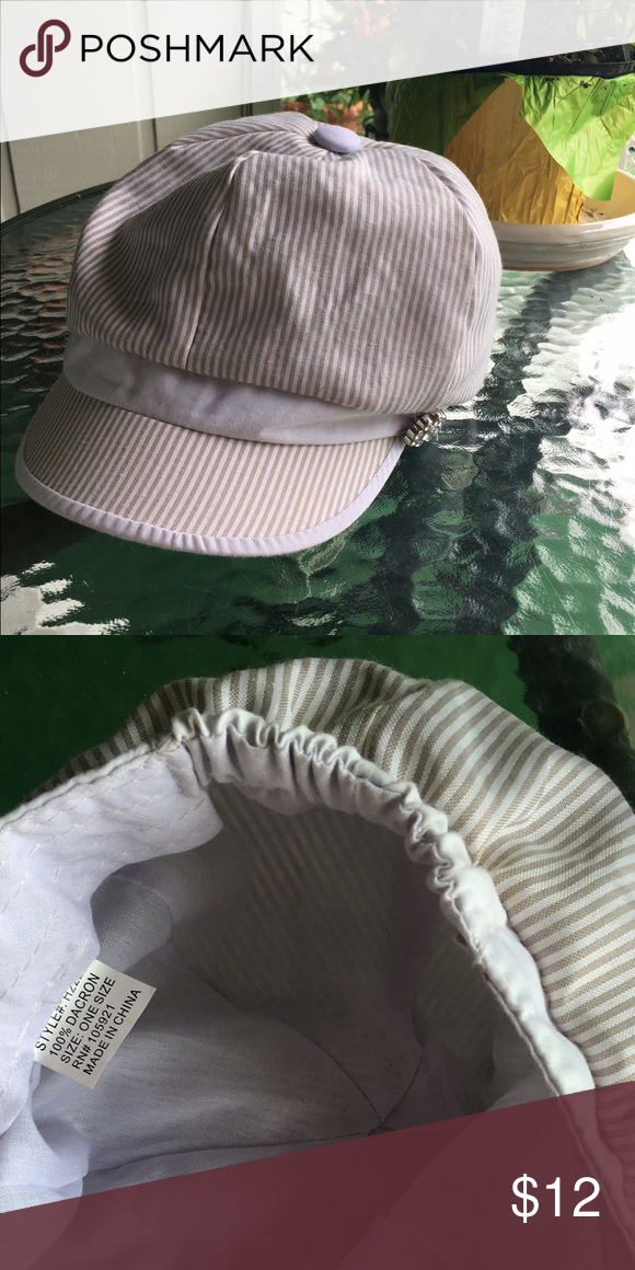 White/Gray striped hat White/gray striped hat with sparkle gem attached. Gently worn. Good condition. Accessories Hats