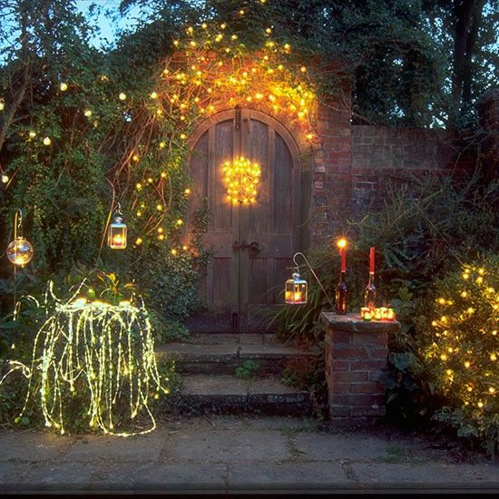 garden bushes decorated with fairy lights l outdoor christmas lighting ideas l christmas 2013 l photo