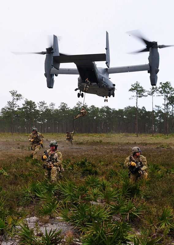 Soldiers provide perimeter security as other soldiers fast rope from an Air Force CV-22 Osprey aircraft during exercise Emerald Warrior 2012 at Hurlburt Field, Fla., Feb. 29, 2012.
