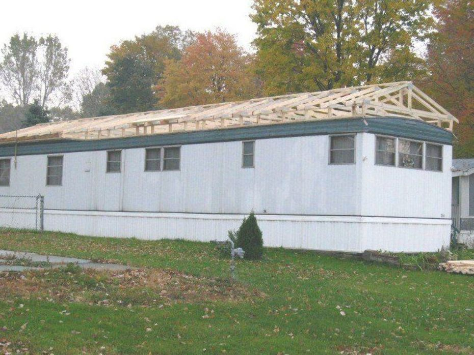 Build a roof over an existing mobile home roof Mobile