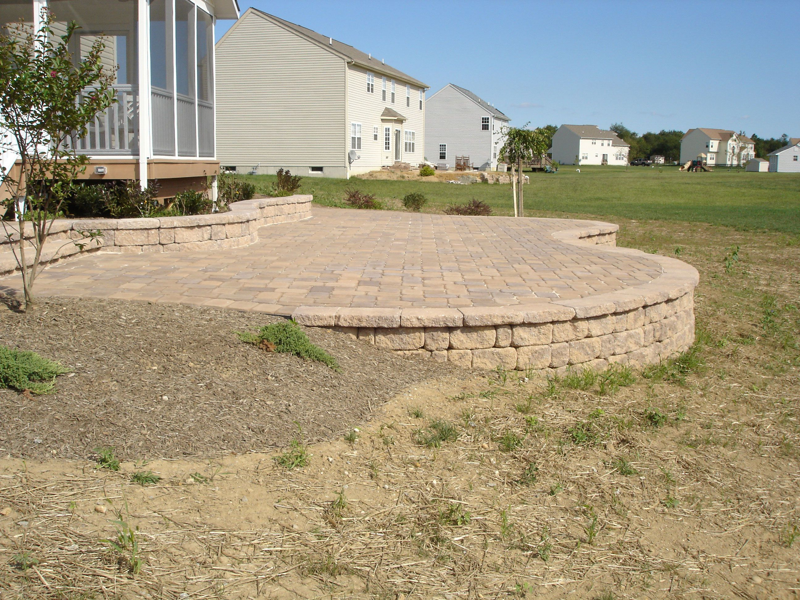 Elevated Paver Patio With Retaining Wall For The Home