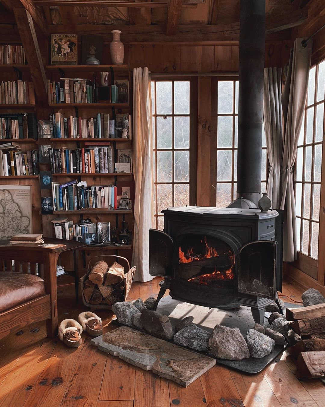 Nothing says cozy like a burning stove and plenty of reading material... (📸: Forestbound via Instagram)