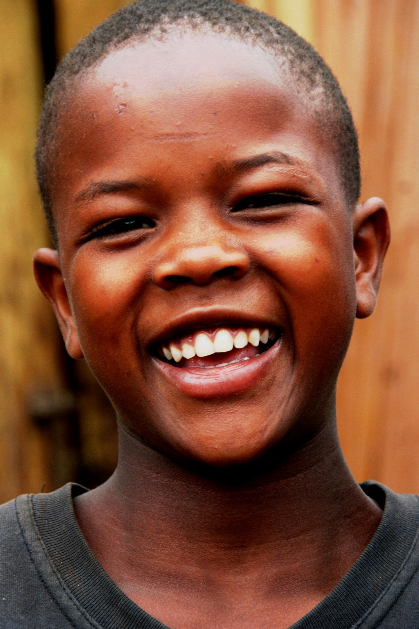 Although he's from the Orphanage Tanzania, this young boy still finds much to smile about. What a happy soul he must have!