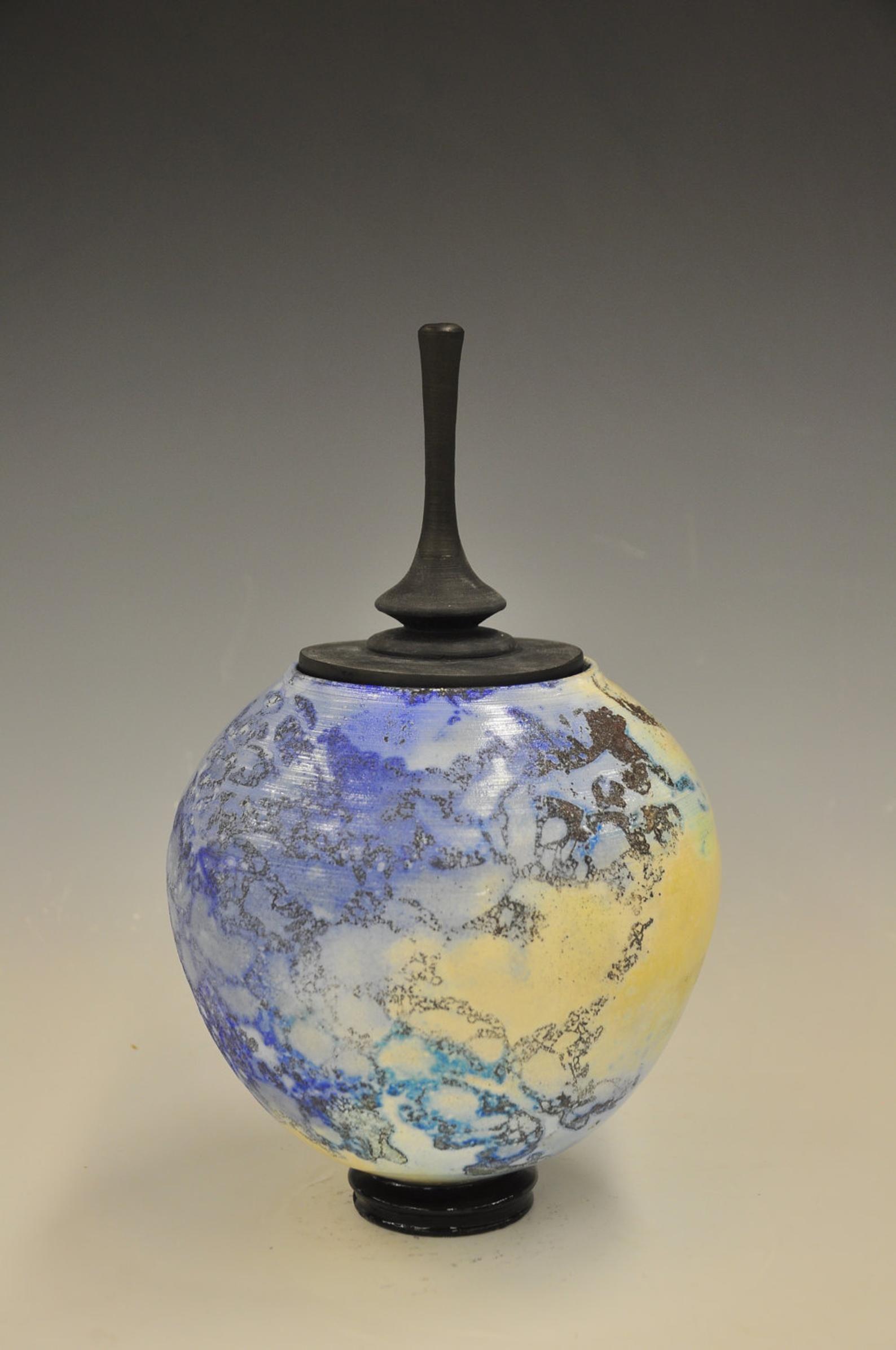 Alternative raku sagger pottery glazed with soluble metal