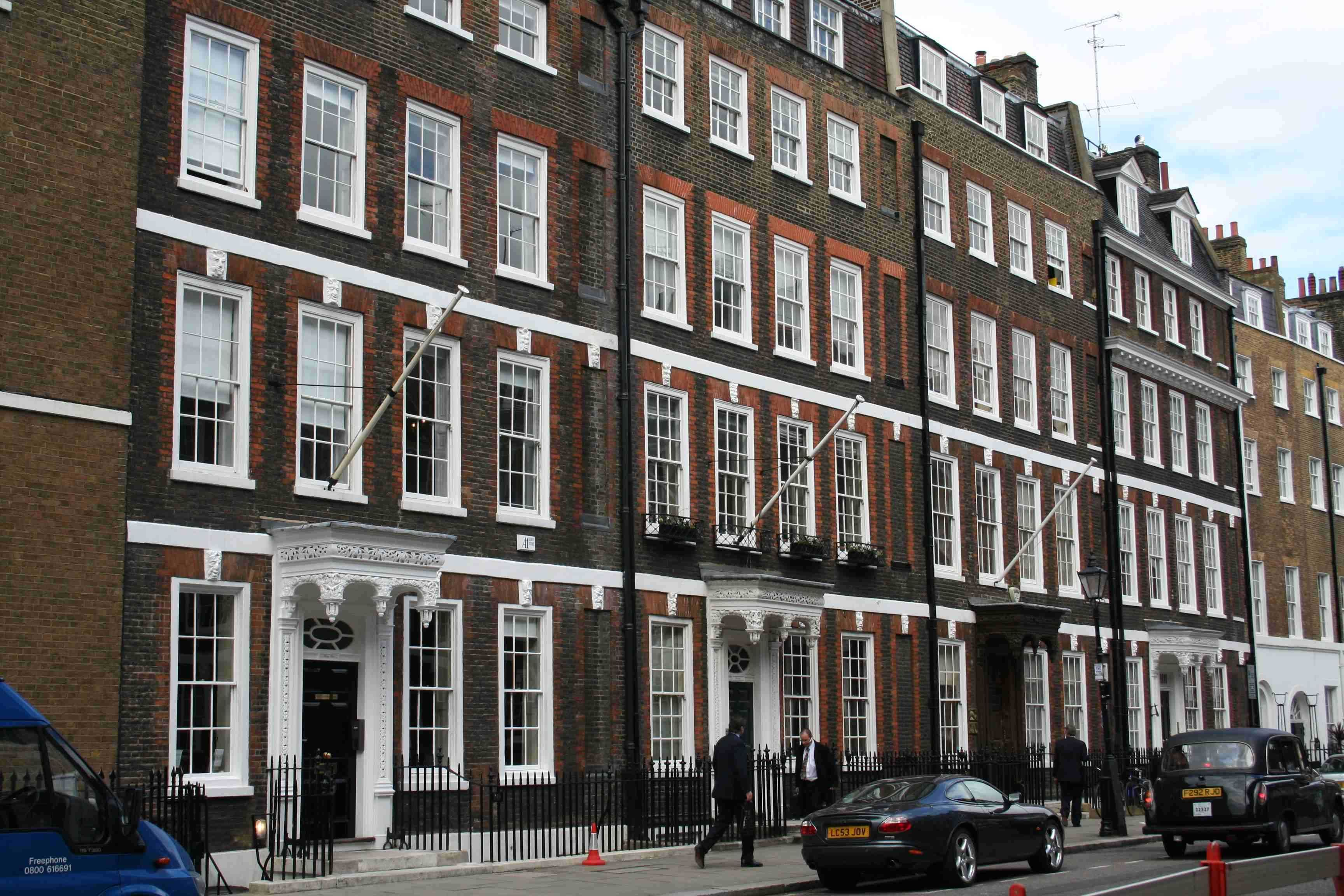 A Row Of Terraced Houses In Grosvenor Square London Homes For