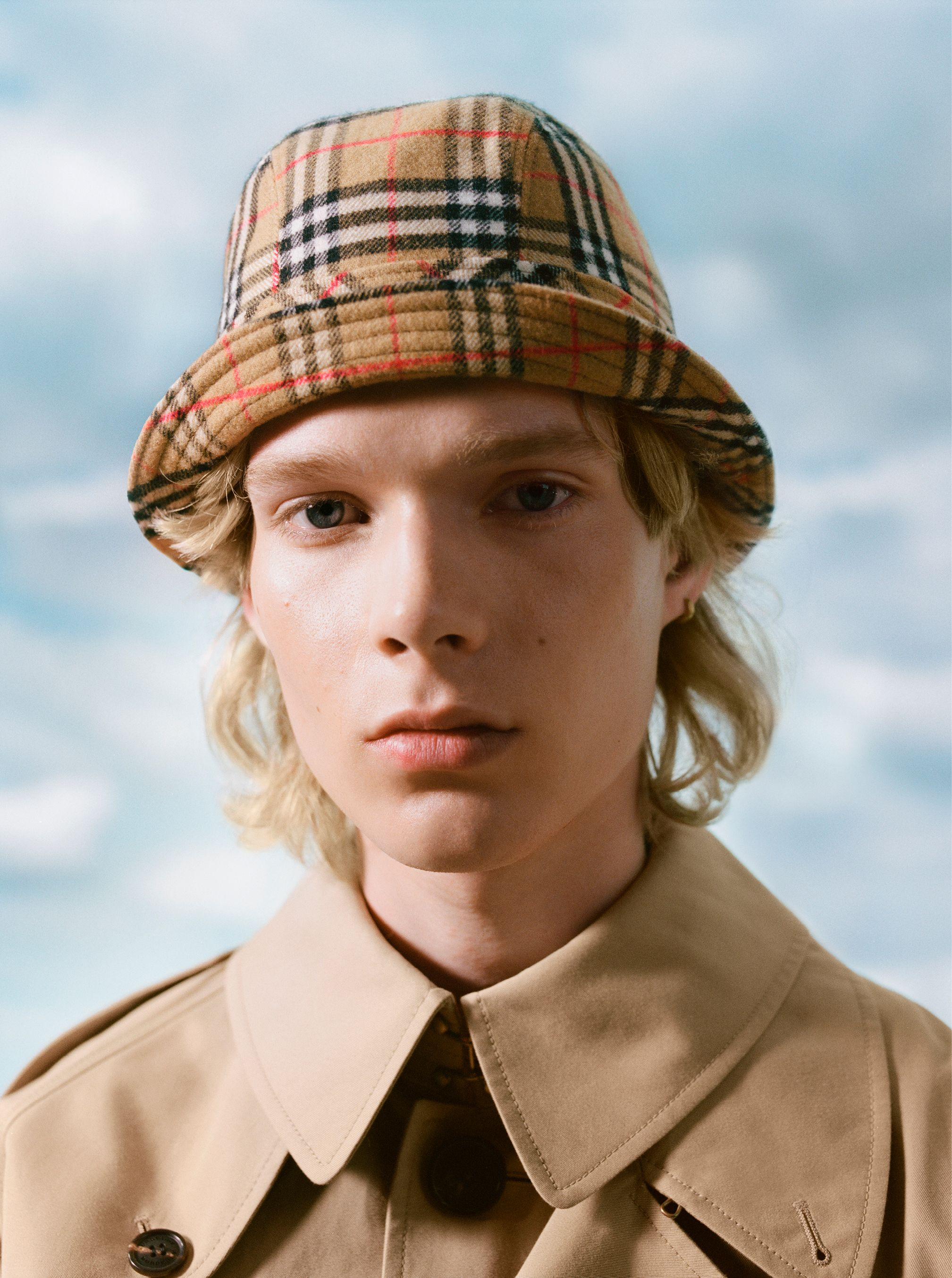 8b2dec11358 Aaron wears the check flannel bucket hat with the reconstructed cotton  gabardine trench from  GoshaRubchinskiy s second drop for  Burberry