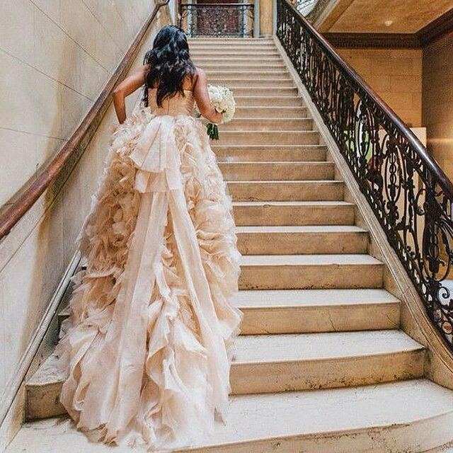 Follow us on instagram for even more wedspiration - http://instagram.com/bridalmusings Ruffles for days! We are in love with this blush pink @moniquelhuillier gown. How about you? Gorgeous photo by @themelideos