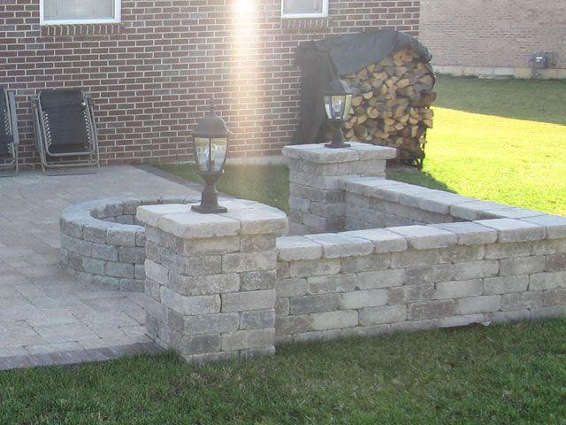 Backyard patio, stone wall, lights. Idea for my future ...