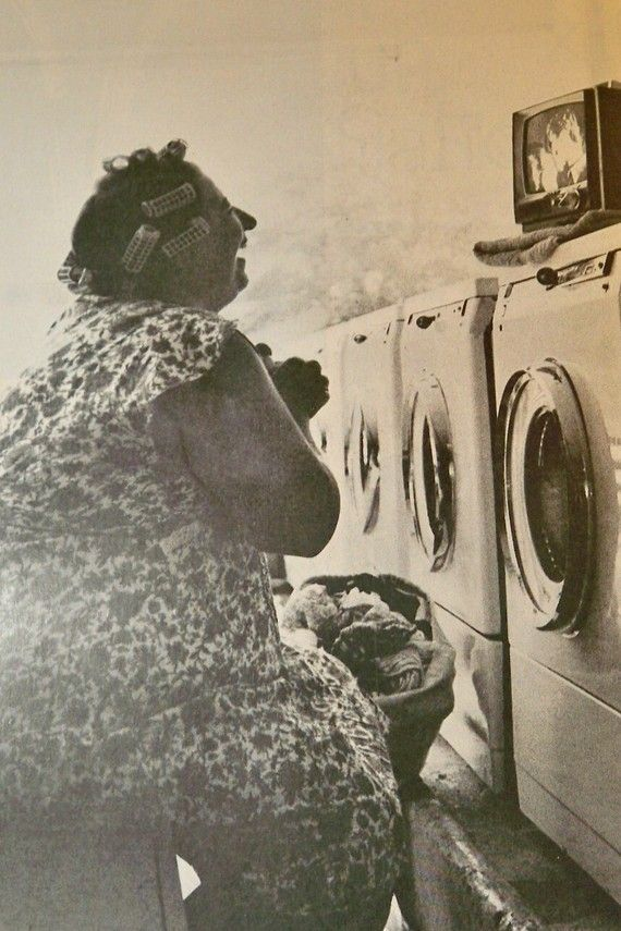 Housewife Watching Soaps At The Laundromat Laundromat Washing Clothes Photo