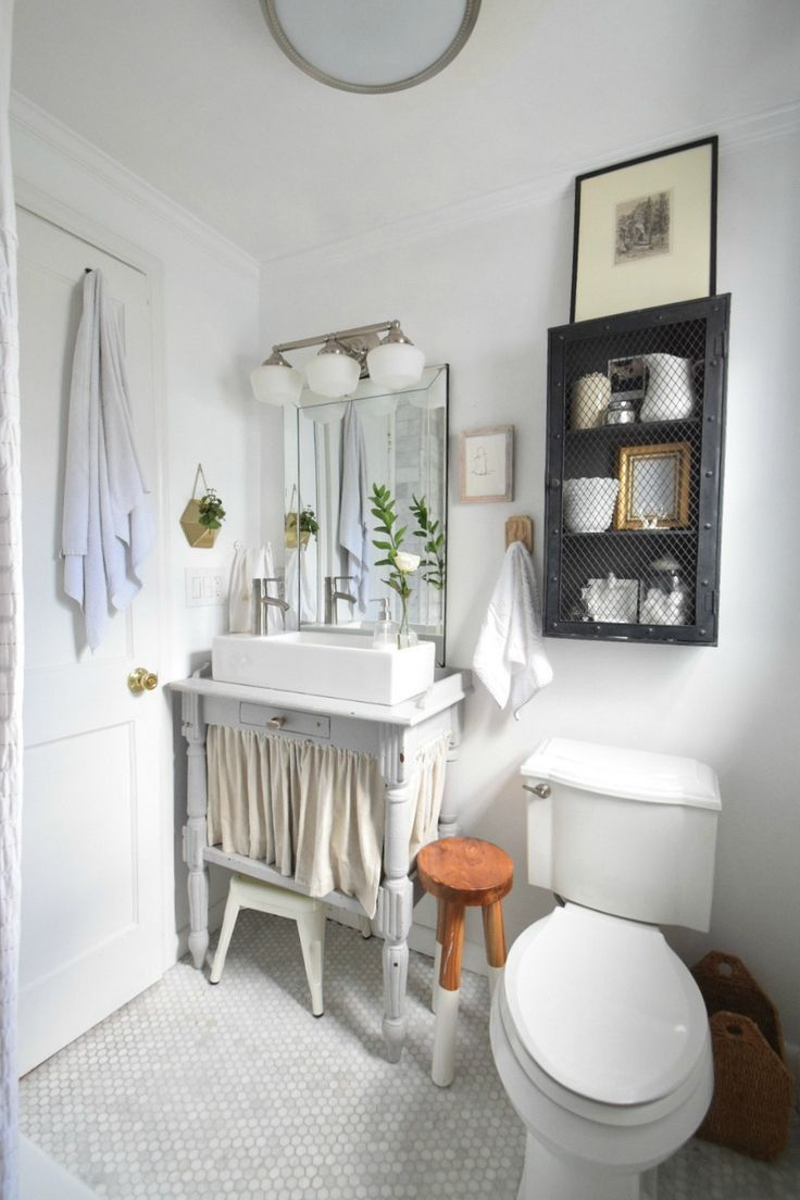 Small Bathroom Ideas- Storage in our Tiny Cape #smallspaceliving #coastalstyle #nestingwithgrace #bathroomdecor #smallbathroom