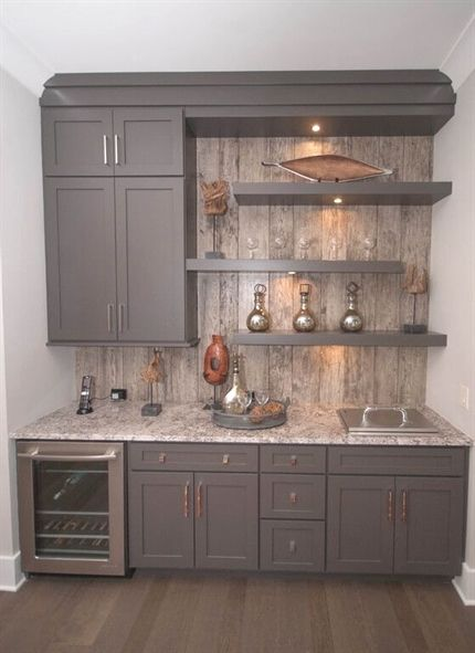 A Contemporary Gray Home Bar With Open Shelving And Rustic Paneling As A Backsplash The Bar