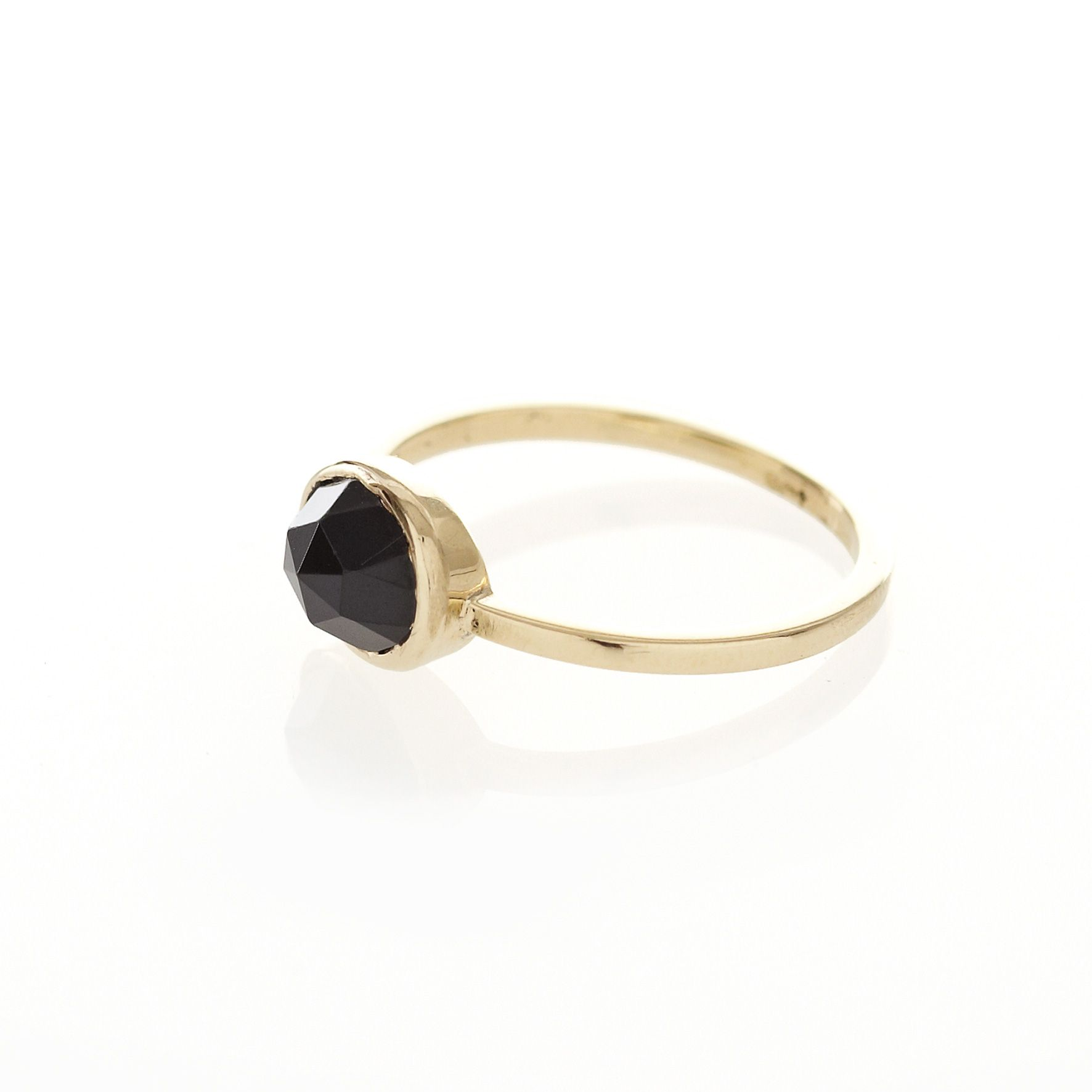 A 9ct Yellow Gold Ring With A Bezel Set 8mm X 6mm Oval Black
