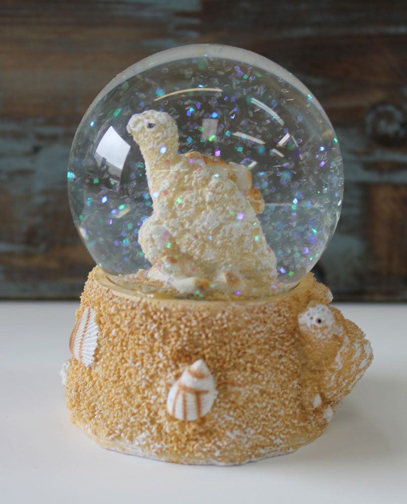 Sea Turtle Snow Globe (http://www.caseashells.com/turtle-snow-globe/) I also have an enormous collection of all sorts of turtles made from all different kinds of materials.