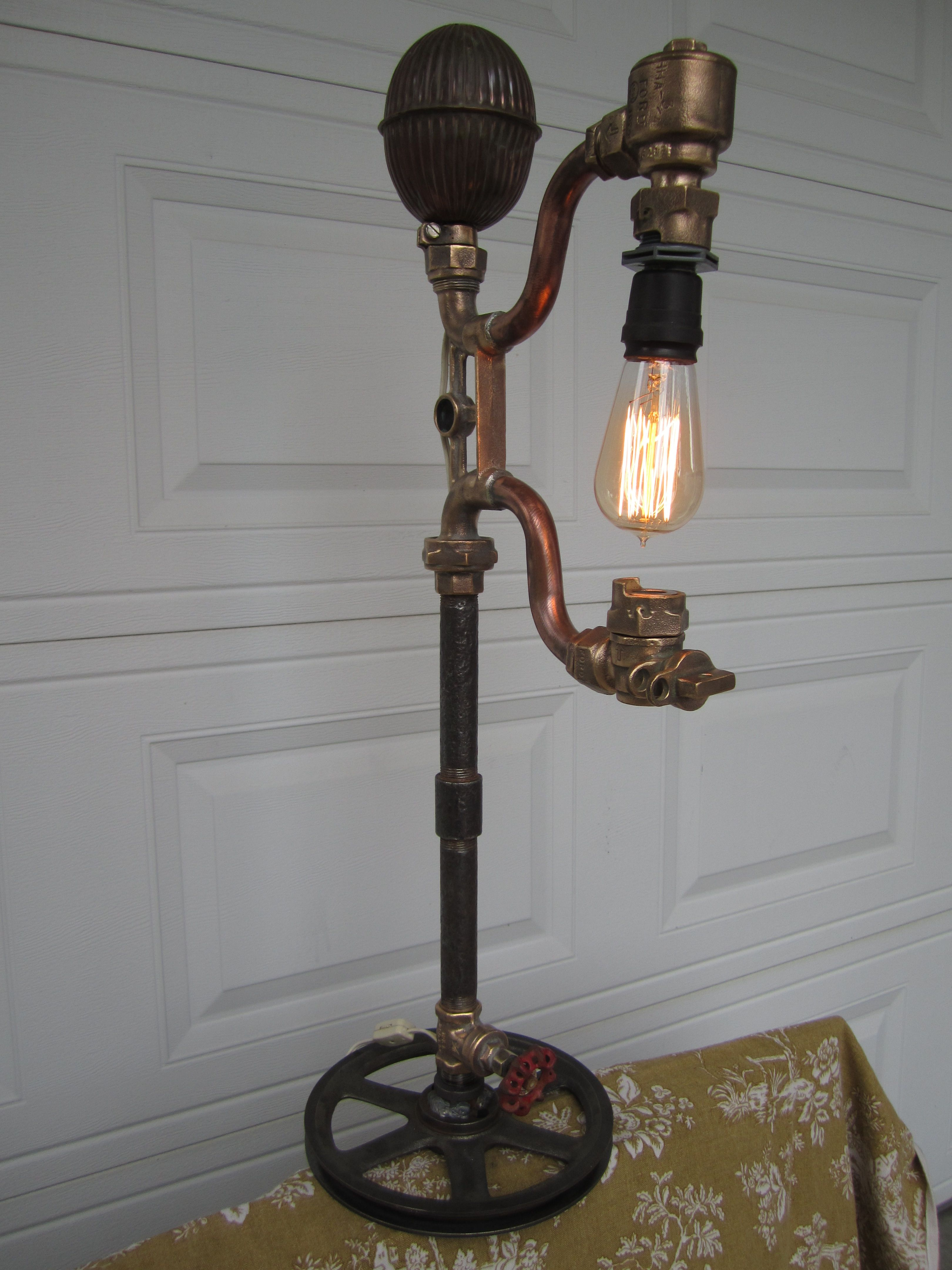 Lamp made from water meter yolk